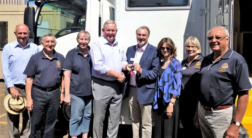 Rotary Club of Karrinyup handing over the keys to Earbus Foundation.