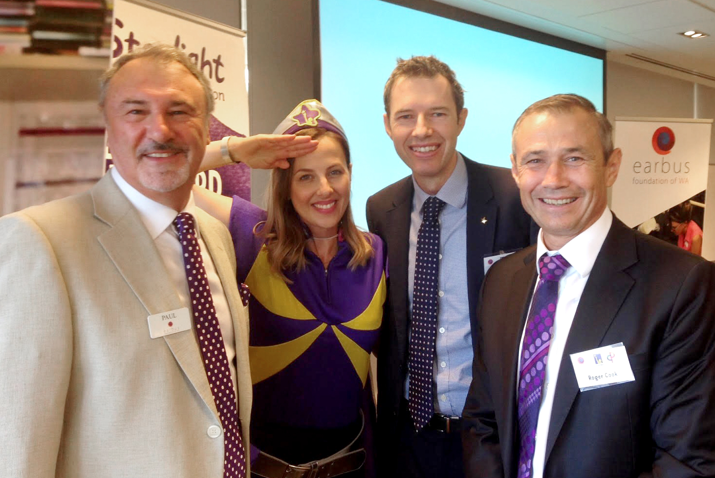 Earbus CEO Paul Higginbotham with Captain Starlight, MC Jack Cullity and new Minister for Health Roger Cook.
