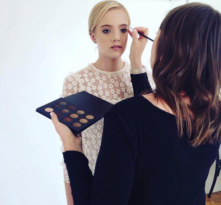 Lucy Blake Applying Makeup