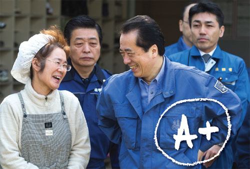 Japan Prime Minister Naoto Kan speaks with an earthquake victim Ryoko Otsubo as he leaves at an evacuation shelter on April 2, 2011 in Rikuzentakata, Iwate, Japan. The death toll continues to rise with numbers of dead and missing exceeding 20,000 in a tragedy not seen since World War II in Japan. Kan has been credited with showing great moral leadership in the face of this crisis. Photo: Athit Perawongmetha/Getty Images