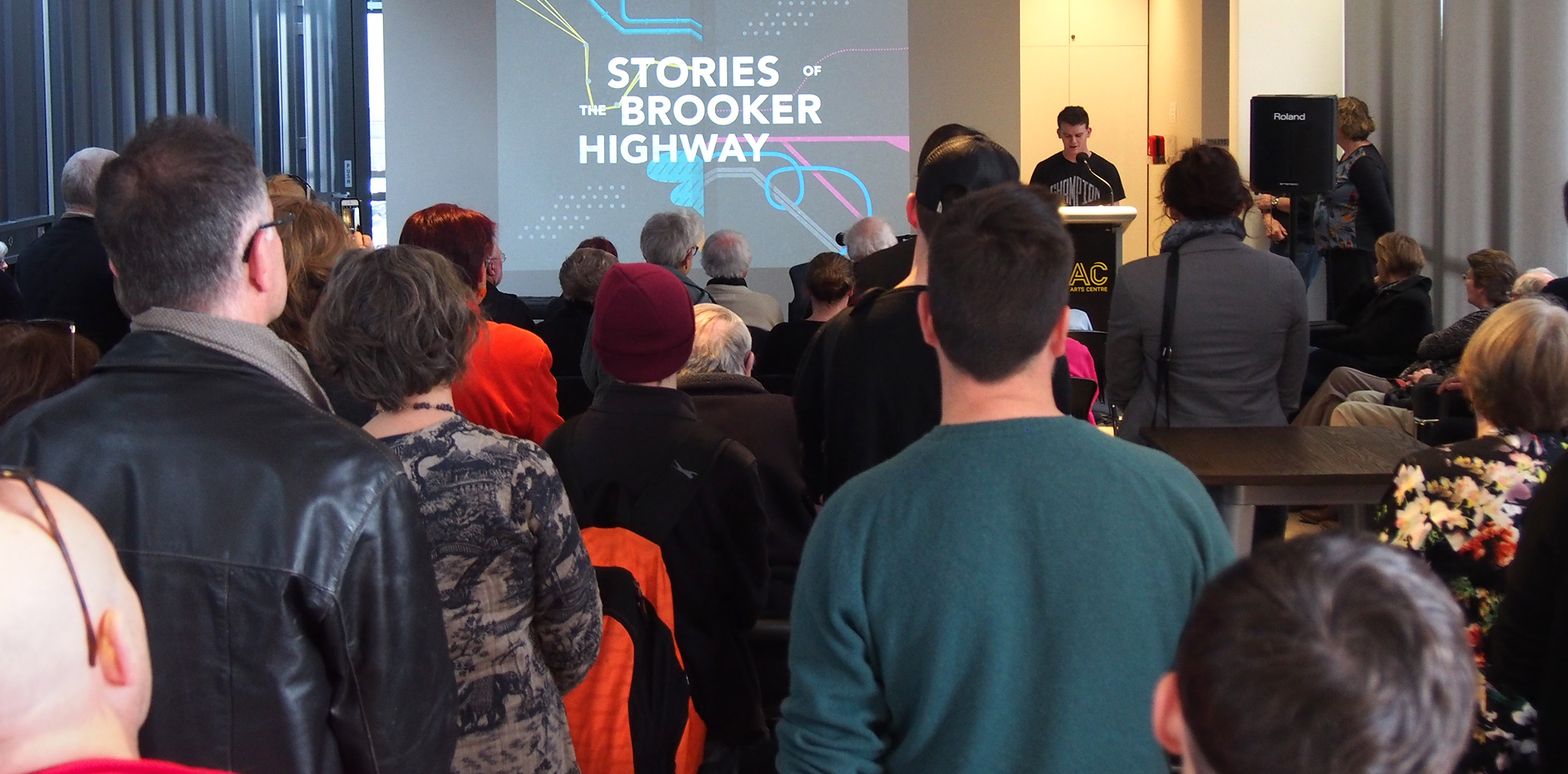 Claremont College student James Finearty reads his piece, 'The Elwick Drive-In', at the  Stories of the Brooker Highway  exhibition launch.