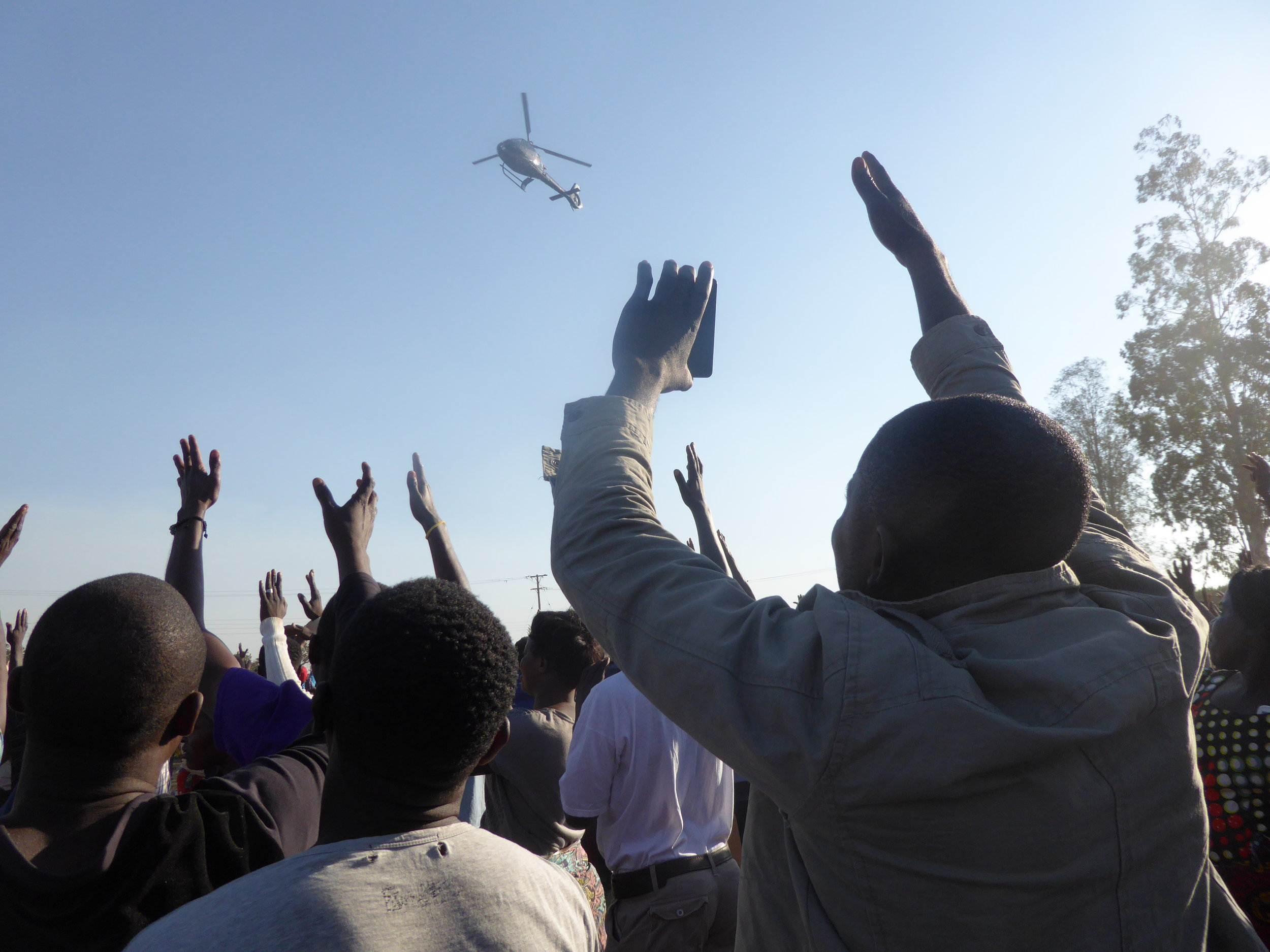 Zambian mobile phone users taking photos of helicopter landing of UPND's presidential candidate, Hakainde Hichilema at a rally in Mandevu, Lusaka Photo: Wendy Willems