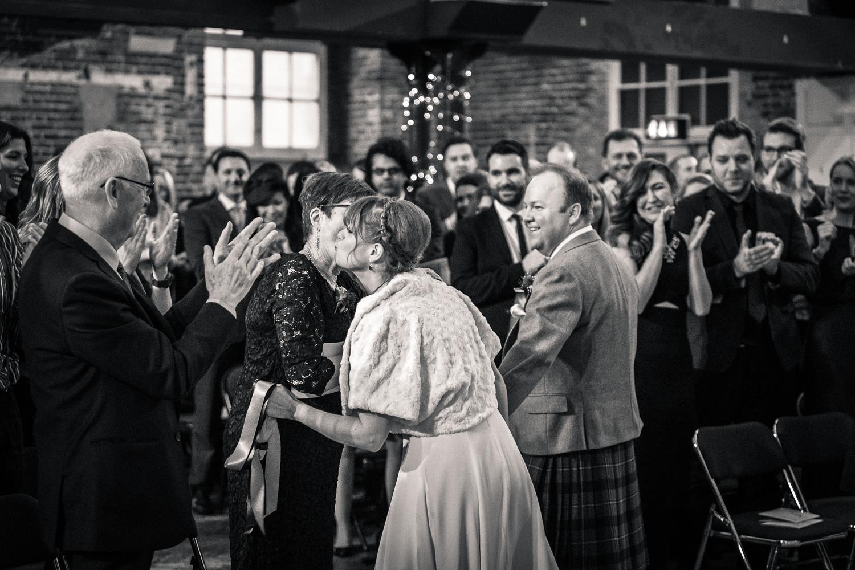 The bride's family congratulate her