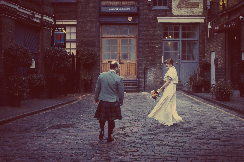 Bride and groom portrait in Bleeding Heart Yard