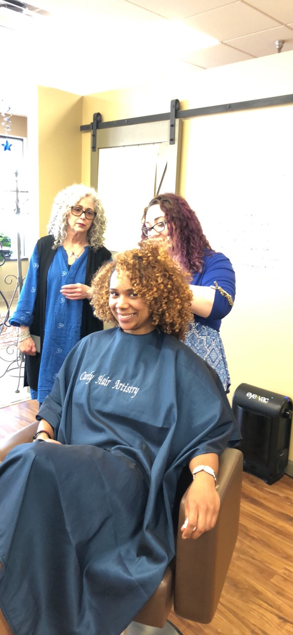 Brooke cutting  Brittney's  curls with  Joni  Observing