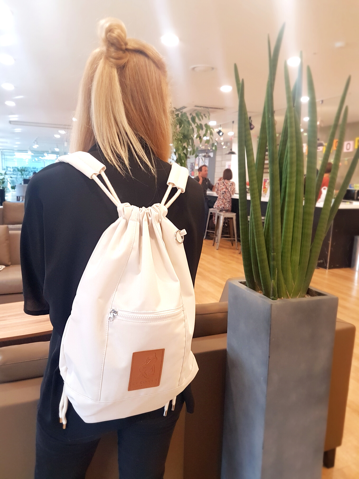 Designer Milla with the backpack.