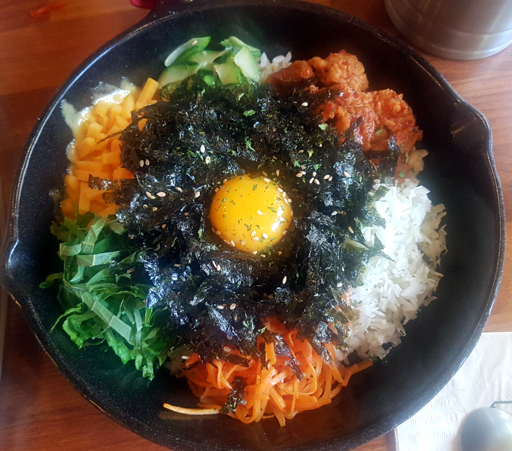 "Warm ""hot pot"" version of bibimbap can look like this for example. This one has even some cheese in the mix. Yam!"