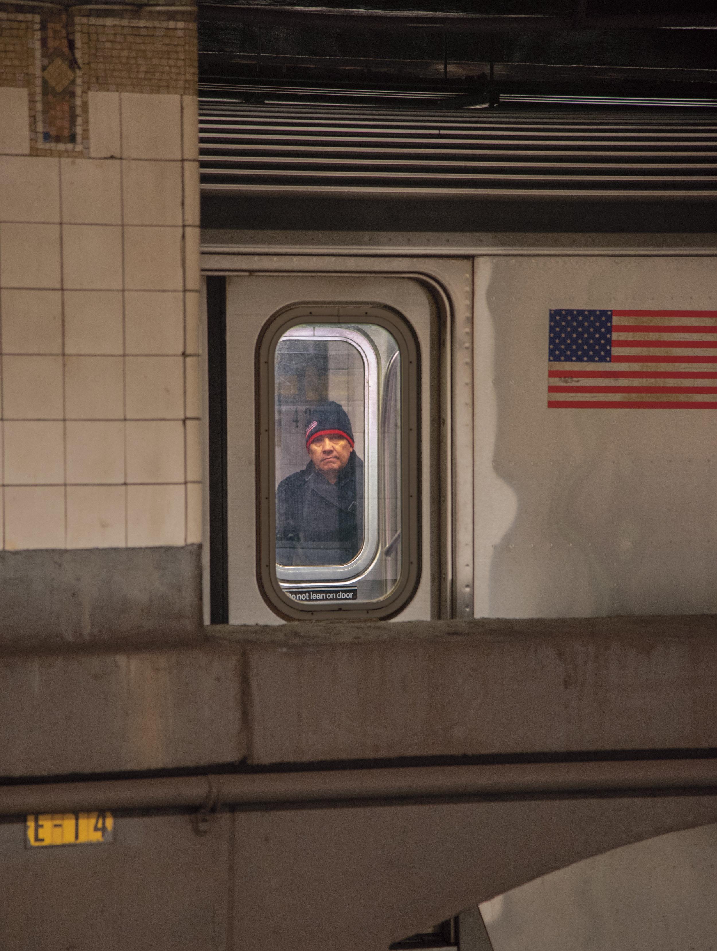 face-through-train-doors.jpg