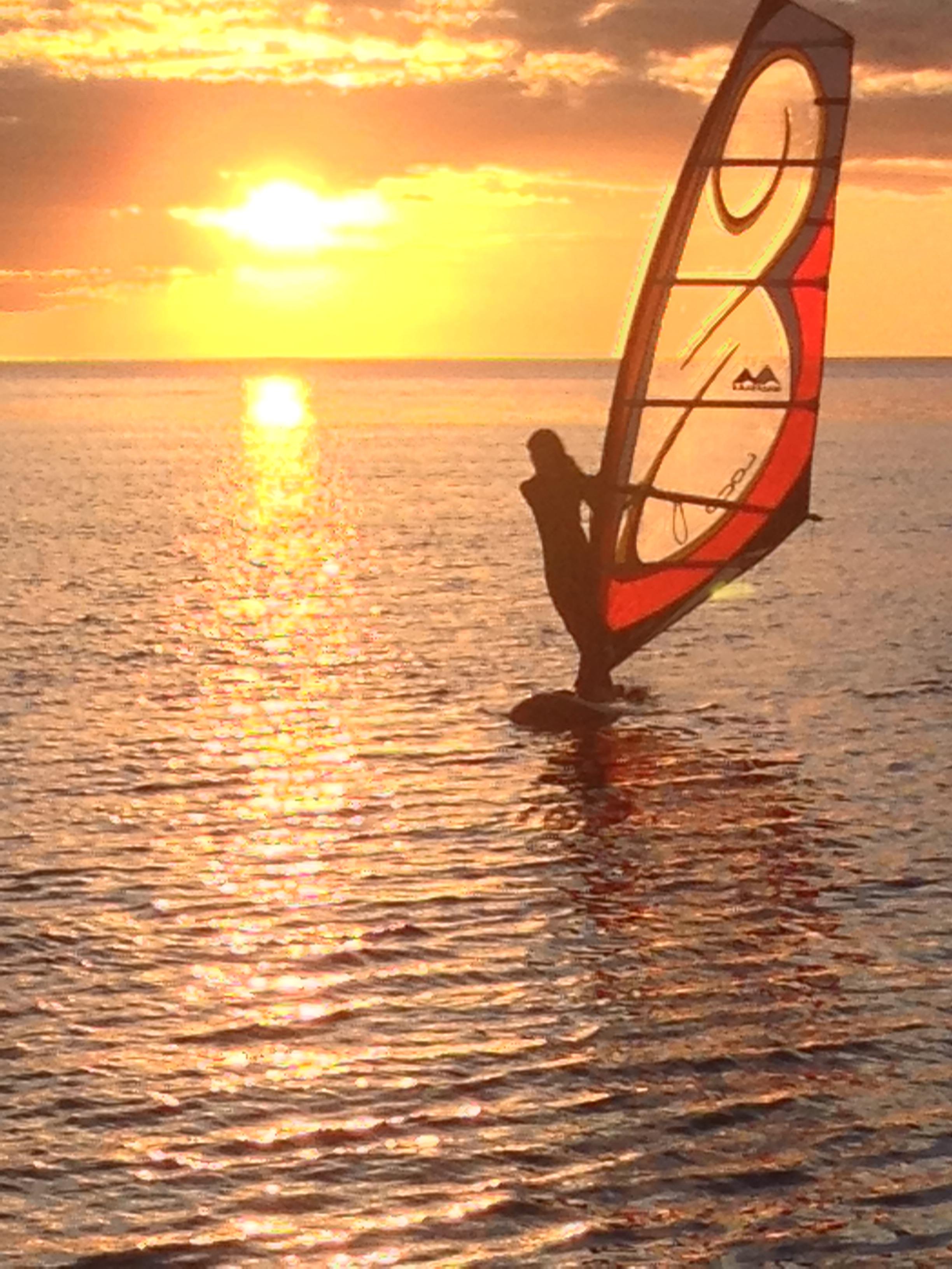 sunset windsurfing