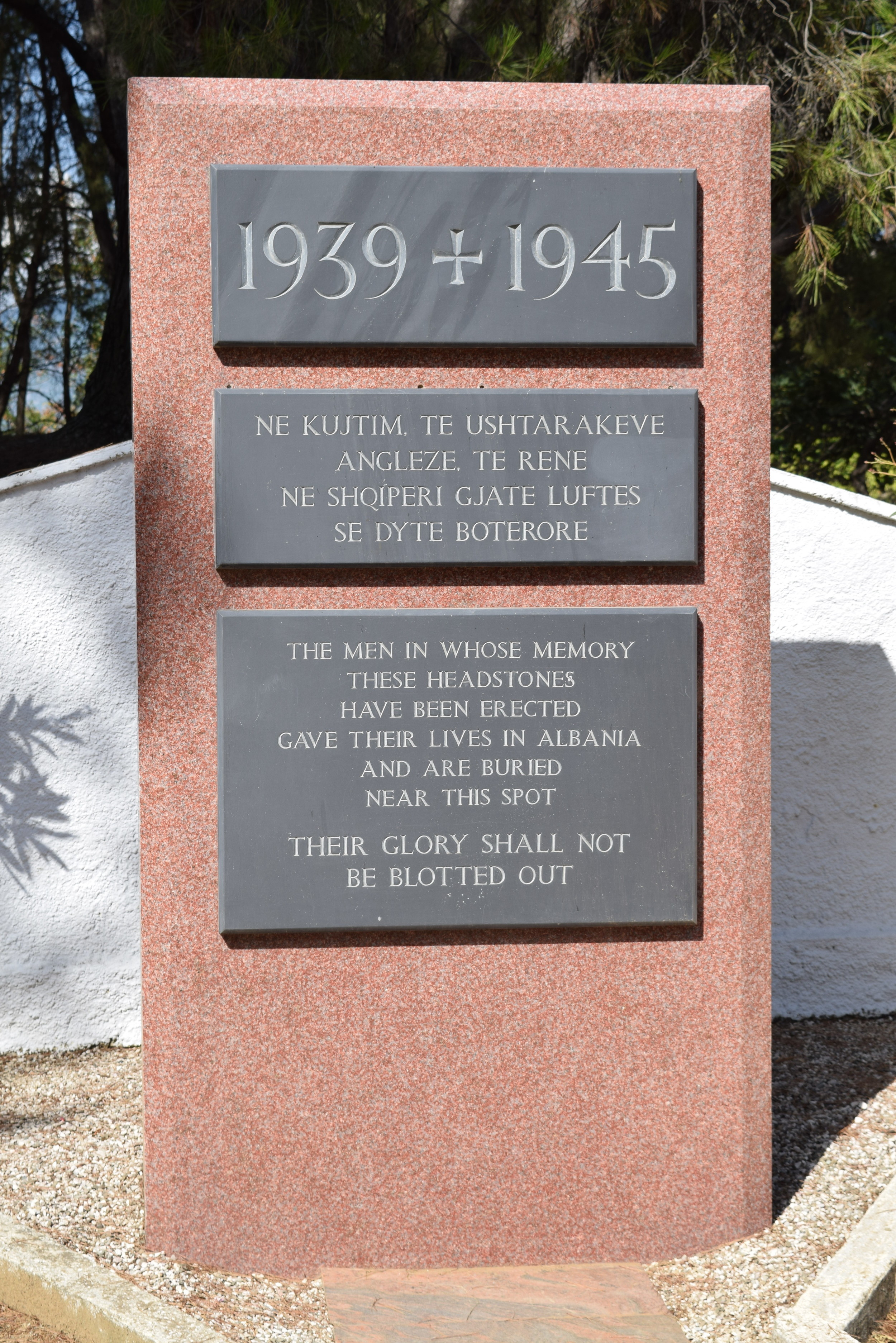 The memorial monument that was once over Enver Hoxha's grave. Notice the small holes above the middle plaque.