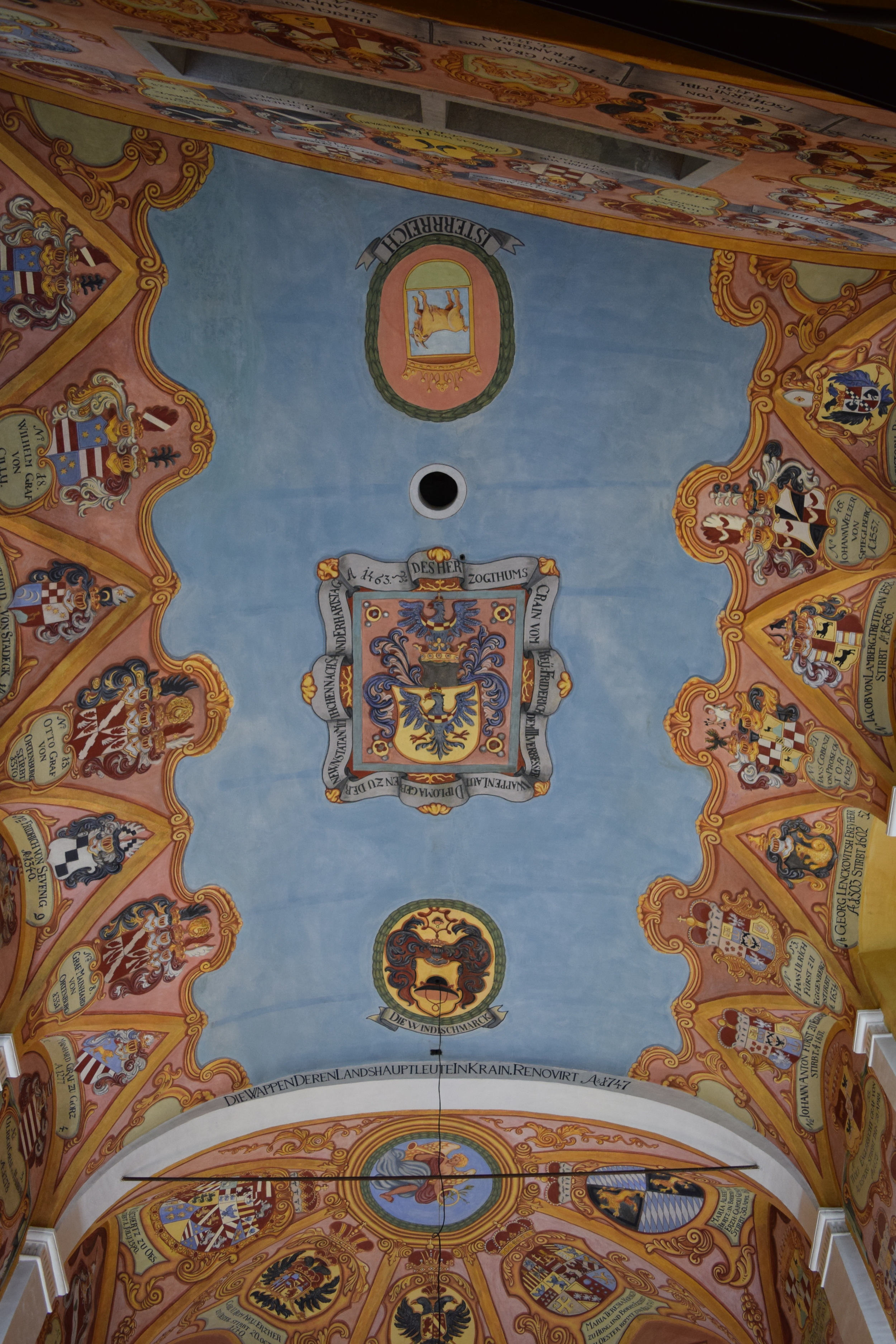 Coats of arms painted on a castle ceiling