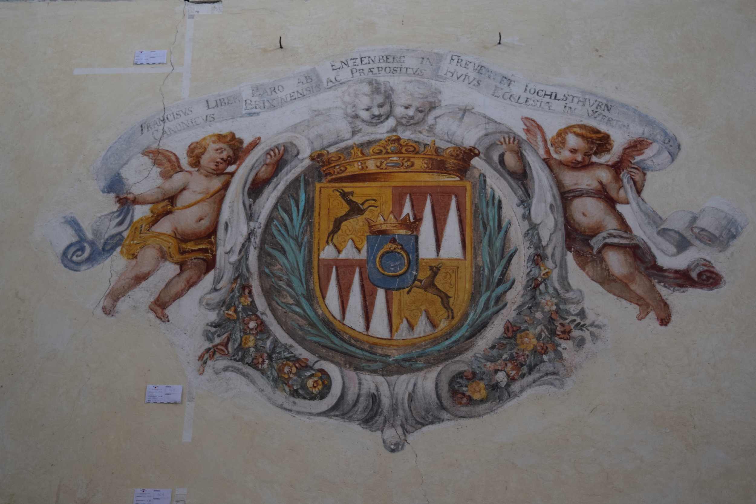 Church fresco displaying the coat of arms of a benefactor