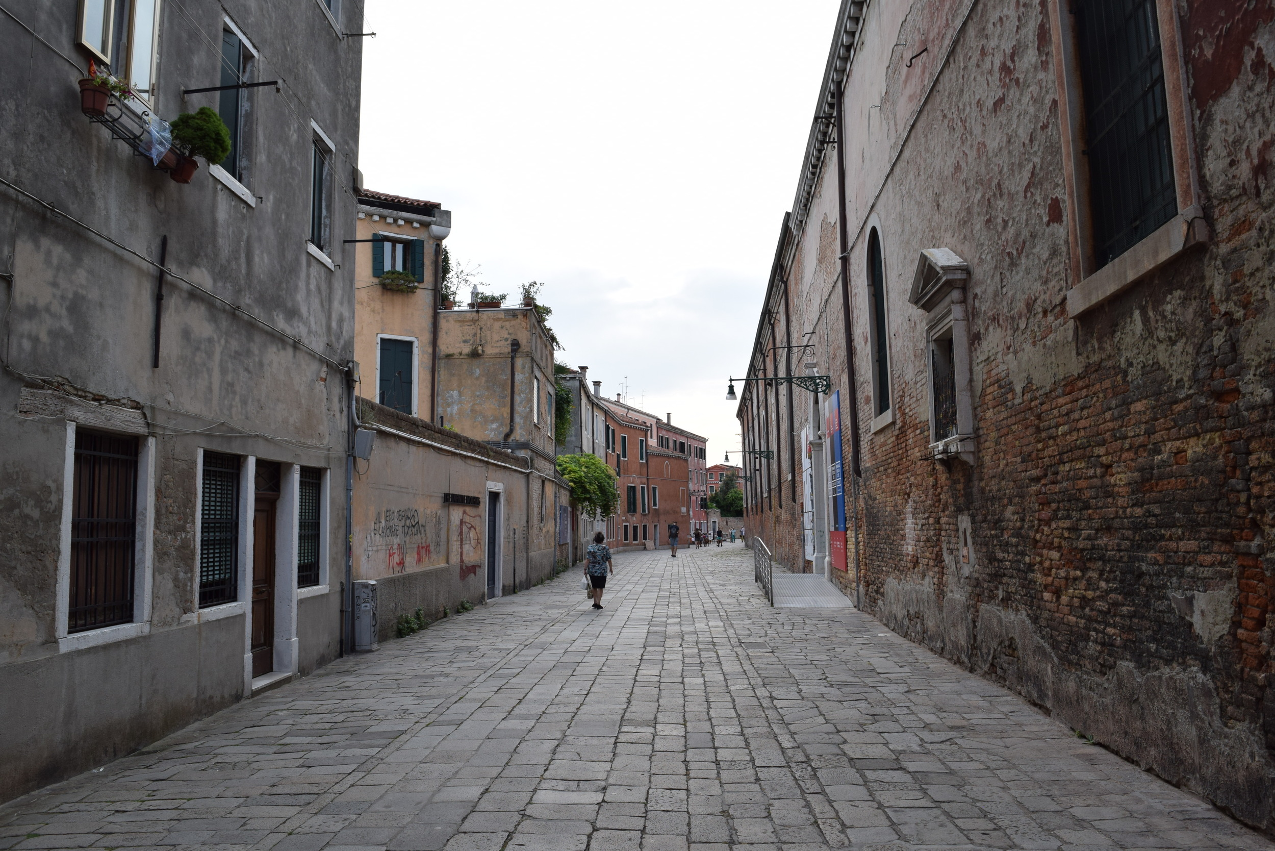 A tranquil street devoid of both canals and crowds