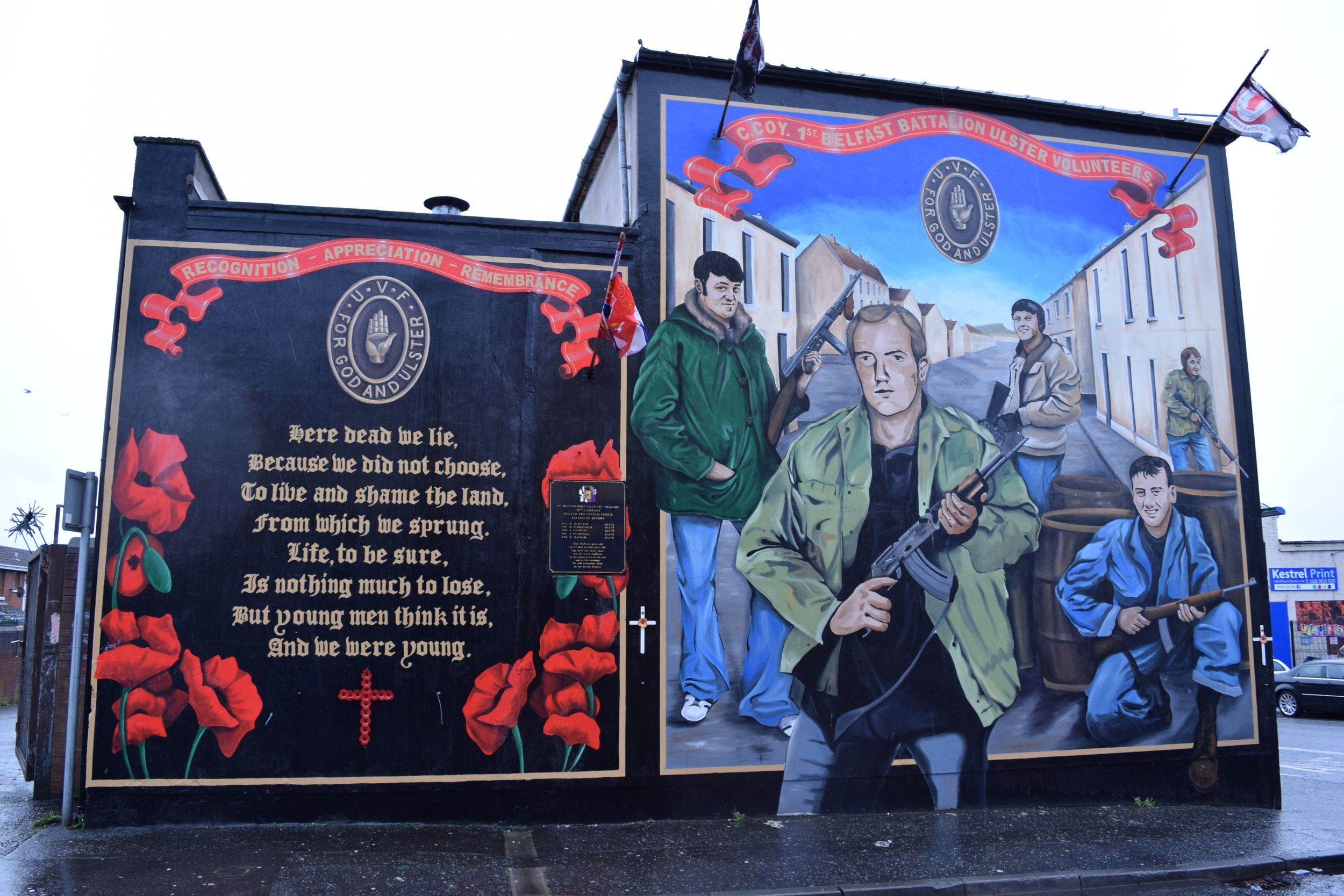 UVF memorial mural utilizing poppy imagery typically associated with World War I remembrance.