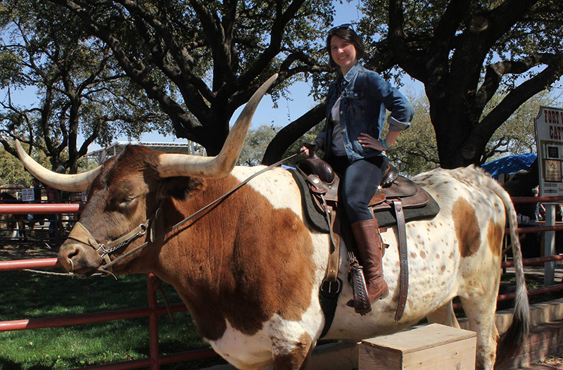 I couldn't resist sitting on top of one of the magnificient Longhorn Bulls.