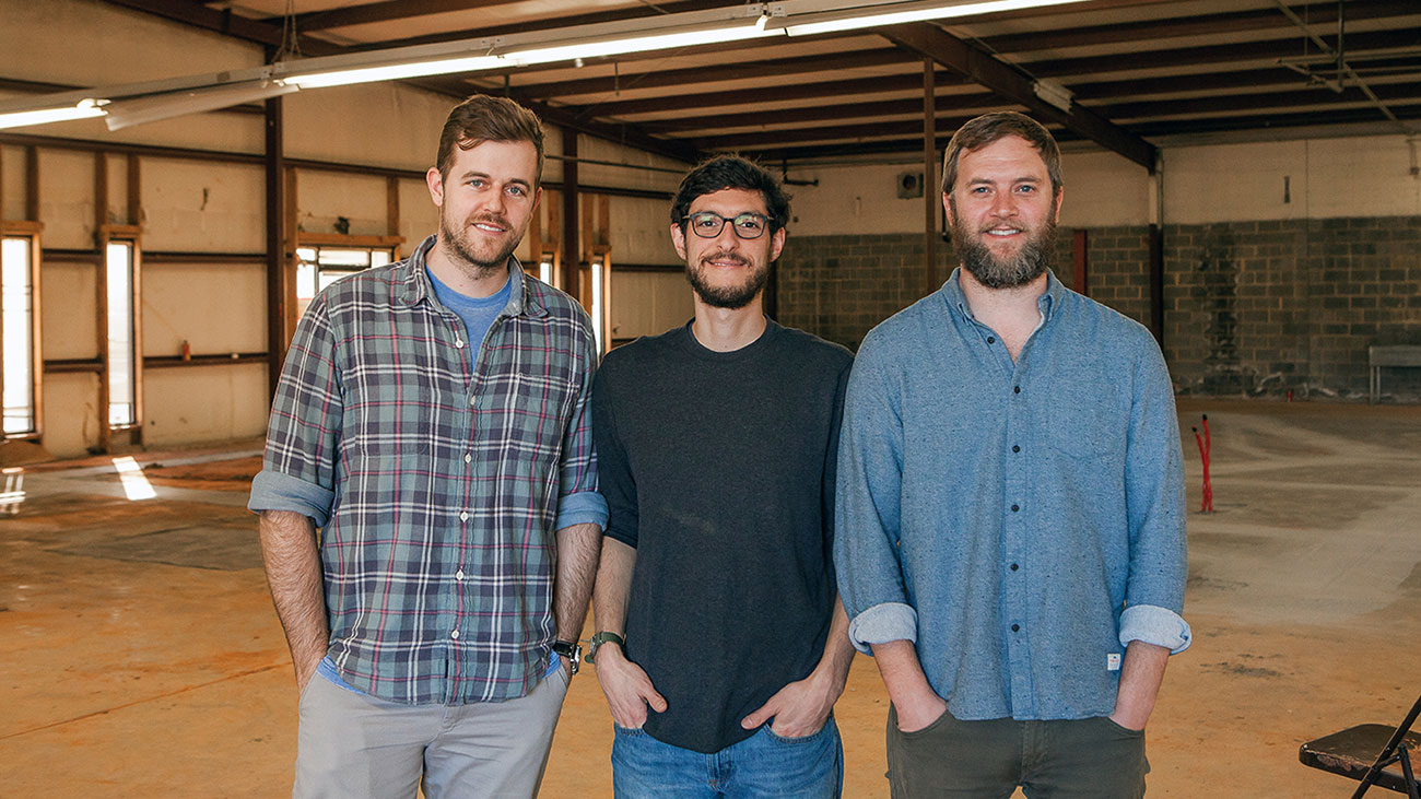 Resident Culture Team inside the future brewery. Photo from Charlotte Agenda; see the full article via the link above