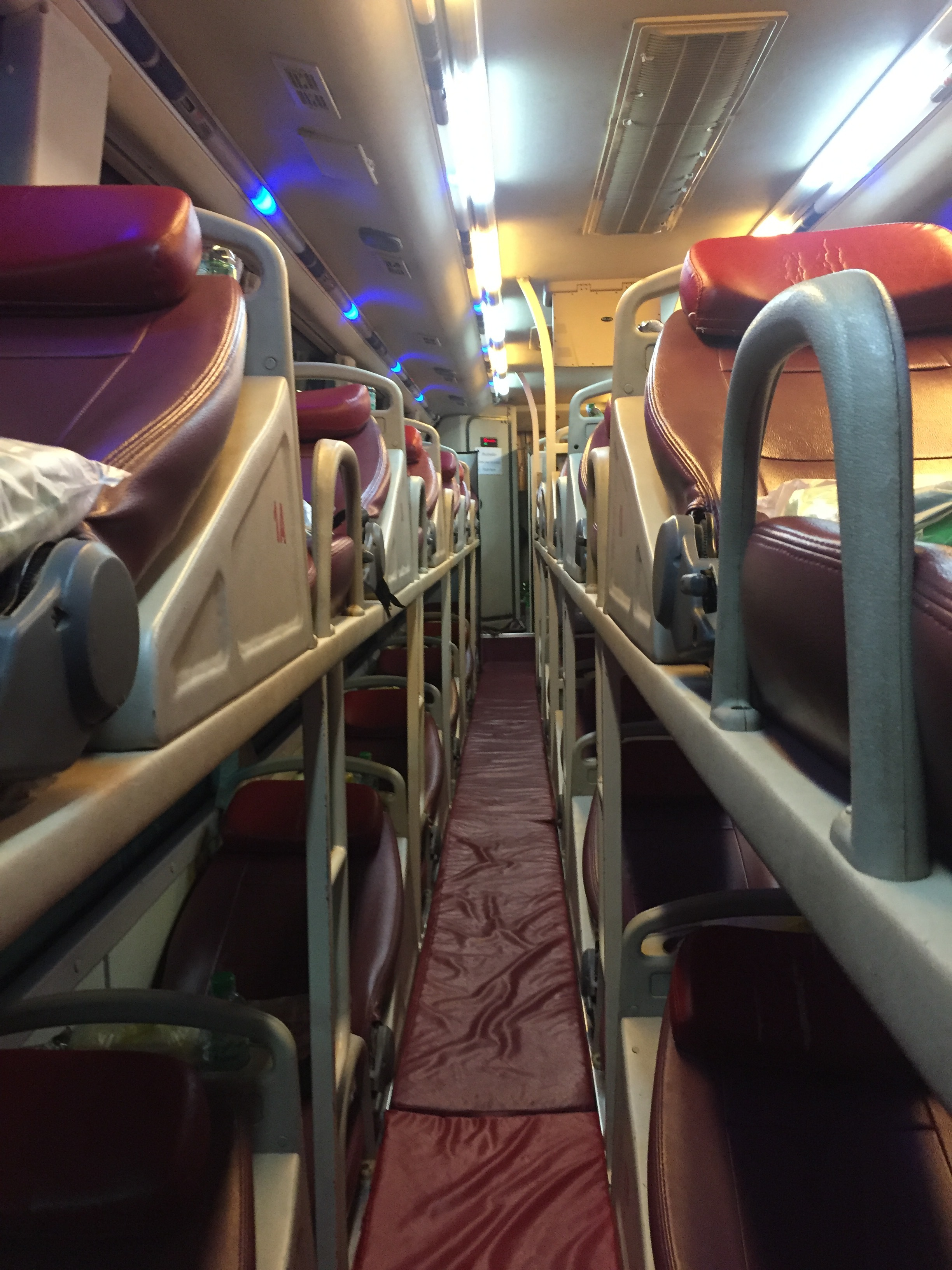 3 rows of seats on the VIP sleeper bus and surprisingly quite comfortable! Blanket, water, and dinner provided.