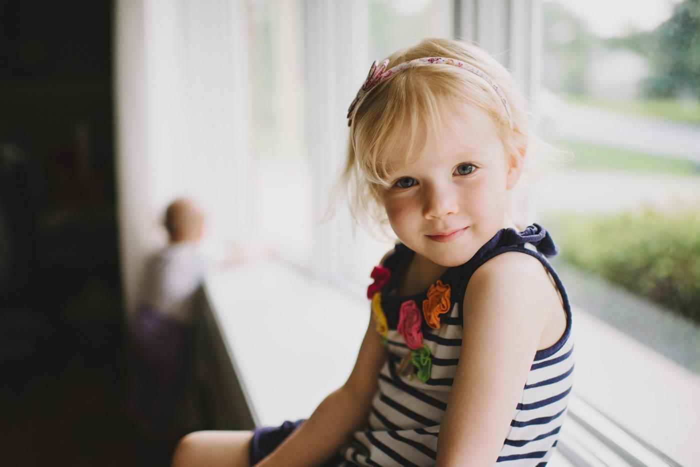 Little girl portrait by window