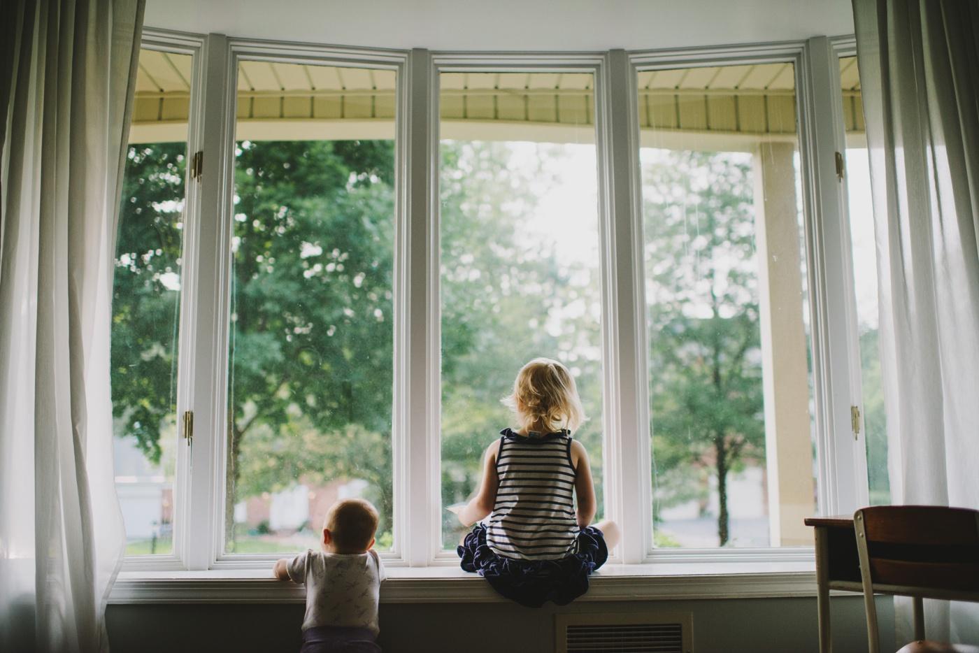 Two little girls in window