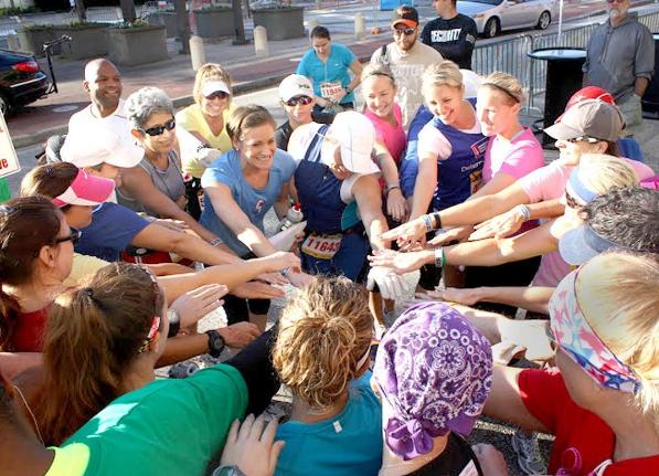 Coach Katie brings her half marathon training team in for a group pep talk.