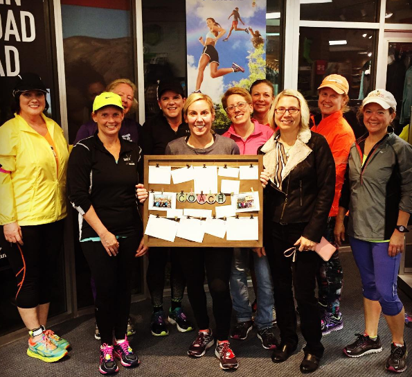 Coach Dawn receives a thank you gift from her group after leading a great 10K program.