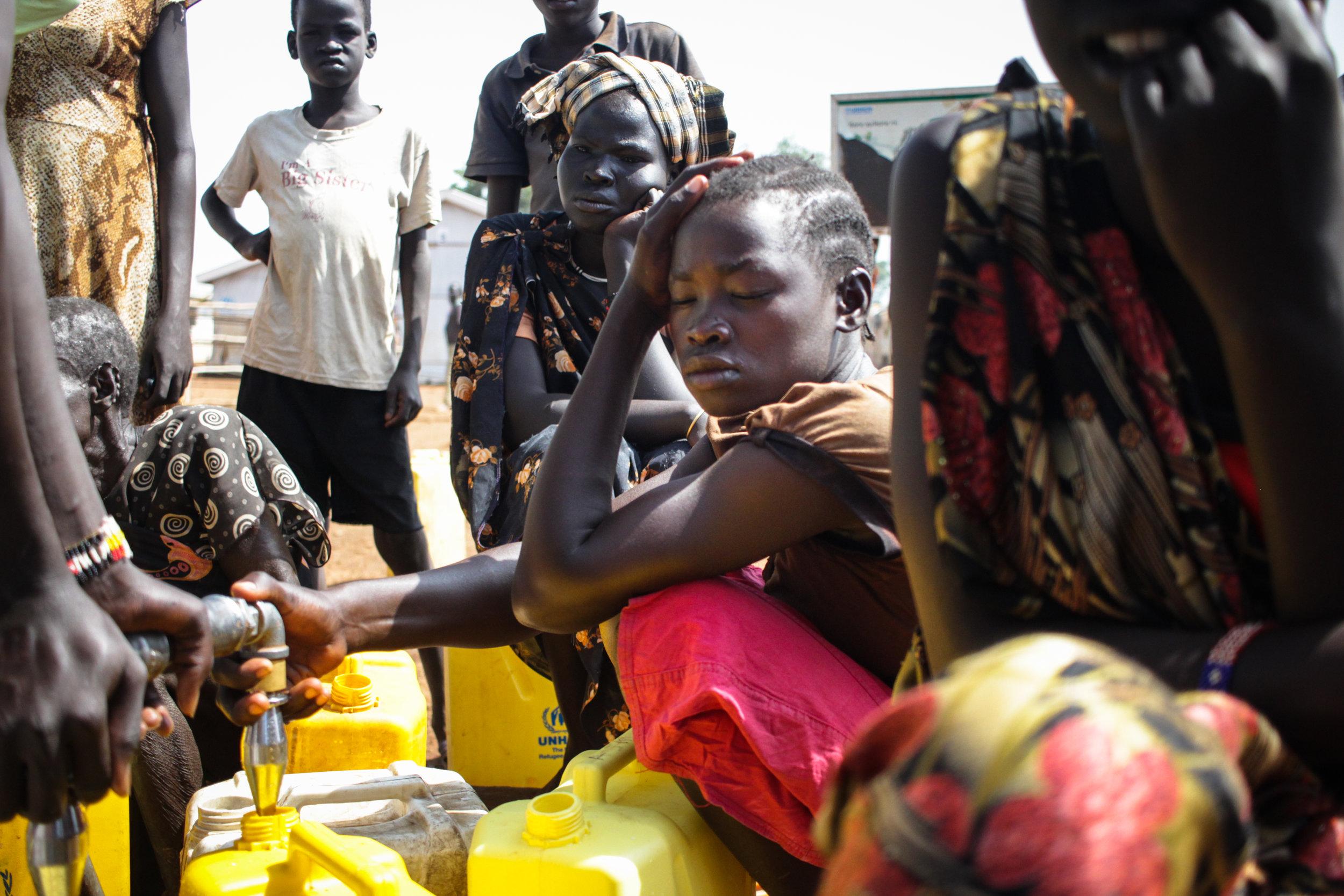 2- Girl Filling Water in Nyumanzi.jpg