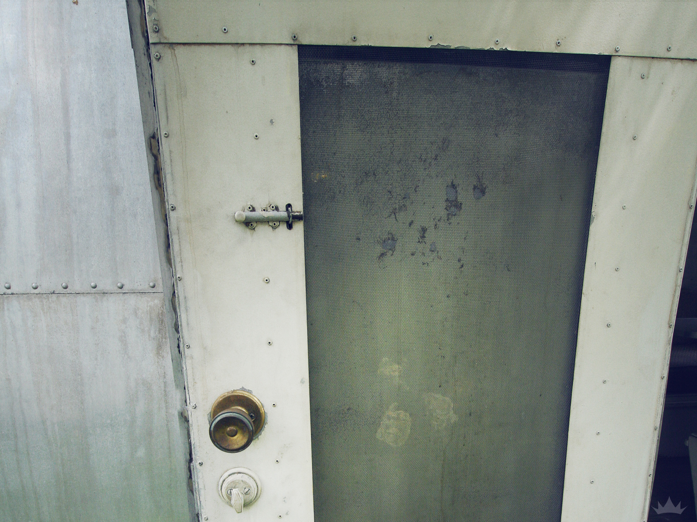 There was also 3-4 coats of paint on the door and hardware, including the original factory paint.