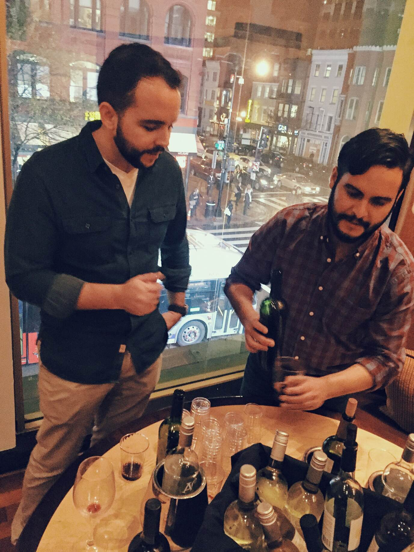 Pedro (left) and Julio (right) pouring and discussing wines with guests at an event hosted by the Greater Washington Hispanic Chamber of Commerce at Zengo restaurant this month.