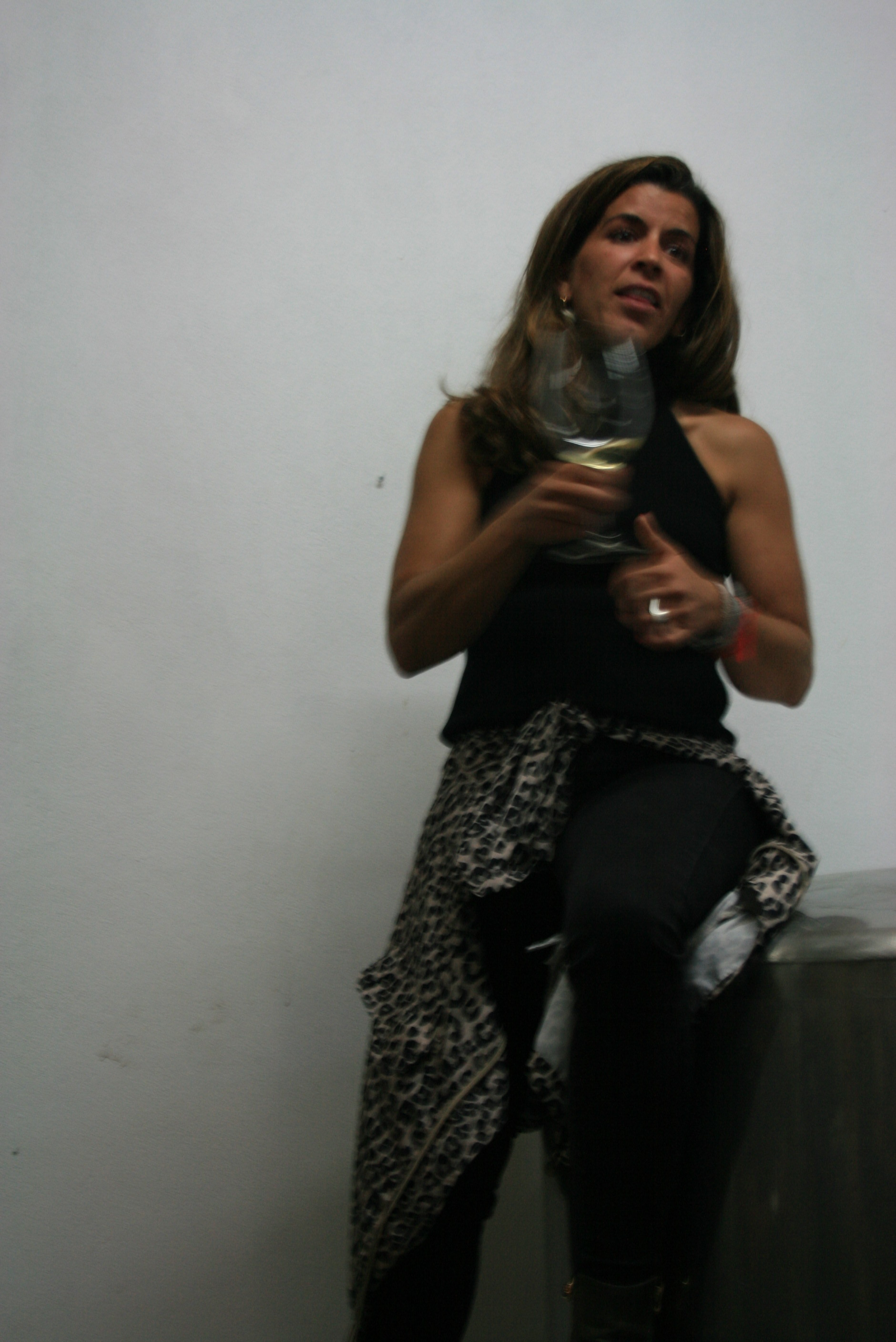 Joana Macanitas holding a glass of white blend in her winery.