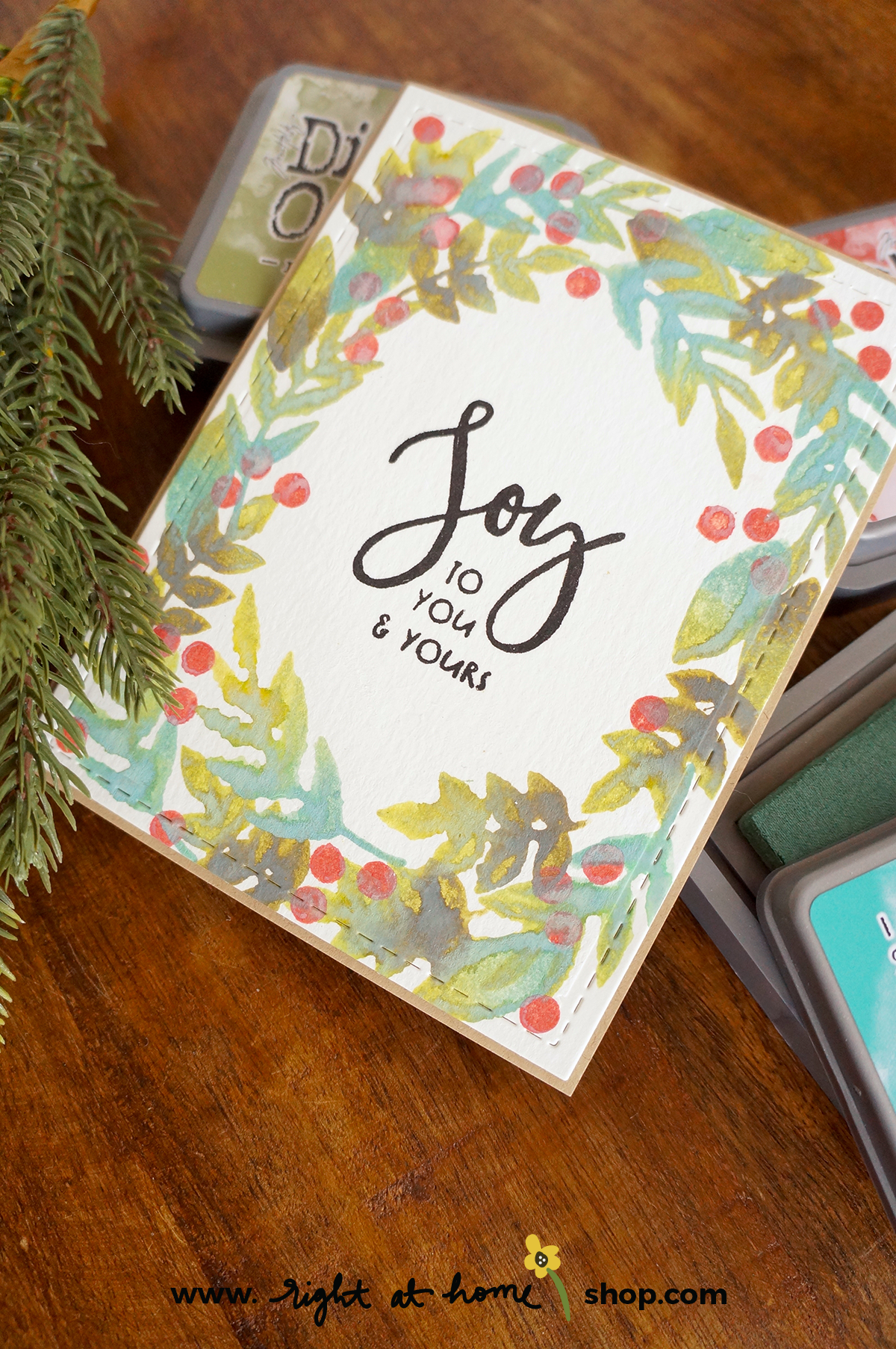 Click to view this Joy holiday card created using the Right at Home Freshly Picked and Brushstroke Alphabet stamp sets. Includes watercolor-inspired stamping using Ranger Tim Holtz Distress Oxide inks. Card design inspired by  Wonder Forest.  All details on www.rightathomeshop.com/blog.