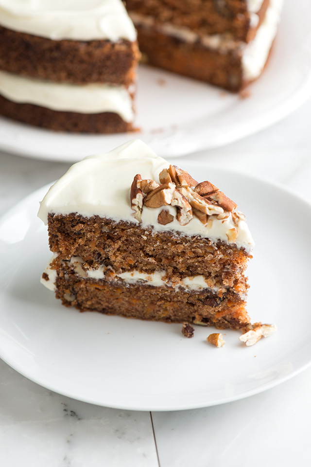 INGREDIENTS    For the Carrot Cake:   2 cups (280 grams) all-purpose flour  2 teaspoons baking soda  1 teaspoon kosher salt  1 1/2 teaspoons ground cinnamon  1 1/4 cups (295 ml) canola or other vegetable oil  1 cup (200 grams) granulated sugar  1 cup (200 grams) lightly packed brown sugar  1 teaspoon vanilla extract  4 large eggs  3 cups (300 grams) grated peeled carrots (5 to 6 medium carrots)  1 cup (100 grams) coarsely chopped pecans  1/2 cup (65 grams) raisins, optional   For the Cream Cheese Frosting:   8 ounces (225 grams) cream cheese, at room temperature  1 1/4 cups (140 grams) powdered sugar  1/3 cup (80 ml) heavy cream  1/2 cup (50 grams) coarsely chopped pecans, for topping cake   DIRECTIONS   Heat the oven to 350º F. Grease two 9-inch by 2-inch cake pans and line the bottom with parchment paper then grease the top of the paper. Or, grease and flour the bottom and sides of both pans.   Prepare Cake Batter  :  In a medium bowl, whisk flour, baking soda, salt and the cinnamon until well blended. In a separate bowl, whisk the oil, sugars and vanilla. Whisk in eggs, one at a time.  Switch to a large rubber spatula. Scrape the sides and bottom of the bowl then add the dry ingredients in 3 parts, stirring gently until they disappear and the batter is smooth. Stir in the carrots, nuts and raisins, if using them.   Bake Cake Layers  :  Divide the batter between the prepared cake pans. Bake until the tops of the cake layers are springy when touched and when a toothpick inserted into the center of the cake comes out clean; 35 to 45 minutes.  Cool cakes in pans for 15 minutes then turn out onto cooling racks, peel off parchment paper and cool completely.   Make Cream Cheese Frosting  :  In a large bowl, beat cream cheese with a handheld mixer on medium speed until creamy, about 1 minute. Beat in the powdered sugar, a 1/4 cup at a time until fluffy. Pour in cream and beat on medium speed for 1 minute. Chill covered until ready to frost cake.   Frost Cake  :  When the cake layers are completely cool, frost the top of one cake layer, place the other cake layer on top. Decoratively swirl the top of the cake with remaining frosting, leaving the sides unfrosted. Scatter nuts on top.   NOTES    Preparing the Cake Pans  :  Even though it is a bit time consuming, don't skimp on prepping the pans. It's never fun to find your cake layer is stuck to the bottom of your pan. (If this does happen to you, leave the cake pan upside down and allow gravity to do its thing).   How to Make Carrot Cake Cupcakes  :  For cupcakes, we'd recommend baking for 14 to 18 minutes (or until a tester inserted into the center of one comes out clean). Then let them cool for a few minutes in the cupcake pan before transferring them to a cooling rack.  We use kosher salt. If you don't have it on hand, keep this in mind: 1 teaspoon fine sea or table salt = about 1 1/4 teaspoons kosher salt.
