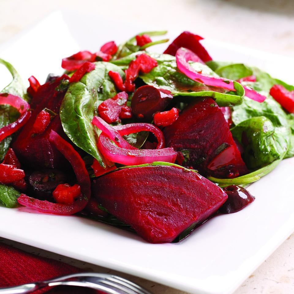 INGREDIENTS   8 cups baby spinach  1 tablespoon extra-virgin olive oil  1 cup thinly sliced red onion  2 plum tomatoes, chopped  2 tablespoons sliced Kalamata olives  2 tablespoons chopped fresh parsley  1 clove garlic, minced  2 cups steamed beet wedges, or slices, 1/2-1 inch thick (see Tip)  2 tablespoons balsamic vinegar  1/4 teaspoon salt  1/4 teaspoon freshly ground pepper      INSTRUCTIONS    Place spinach in a large bowl.    Heat oil in a large nonstick skillet over medium heat. Add onion and cook, stirring, until starting to soften, about 2 minutes. Add tomatoes, olives, parsley and garlic and cook, stirring, until the tomatoes begin to break down, about 3 minutes. Add beets, vinegar, salt and pepper and cook, stirring, until the beets are heated through, about 1 minute more. Add the beet mixture to the spinach and toss to combine. Serve warm.        Tips    How to Prep & Steam Beets: Trim greens (if any) and root end; peel the skin with a vegetable peeler. Cut beets into 1/2- to 1-inch-thick cubes, wedges or slices.  To steam on the stovetop: Place in a steamer basket over 1 inch of boiling water in a large pot. Cover and steam over high heat until tender, 10 to 15 minutes.  To steam in the microwave: Place in a glass baking dish, add 2 tablespoons water, cover tightly and microwave on High until tender, 8 to 10 minutes. Let stand, covered, for 5 minutes.