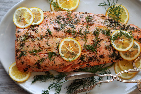 INGREDIENTS   4 tablespoons (1/2 stick) butter  4 tablespoons minced chervil, parsley or dill  1 salmon fillet, 1 1/2 to 2 pounds   Salt and freshly ground black pepper to taste   Lemon wedges      INSTRUCTIONS   Preheat the oven to 475 degrees. Place the butter and half the herb in a roasting pan just large enough to fit the salmon and place it in the oven. Heat about 5 minutes, until the butter melts and the herb begins to sizzle.  Add the salmon to the pan, skin side up. Roast 4 minutes. Remove from the oven, then peel the skin off. (If the skin does not lift right off, cook 2 minutes longer.) Sprinkle with salt and pepper and turn the fillet over. Sprinkle with salt and pepper again.  Roast 3 to 5 minutes more, depending on the thickness of the fillet and the degree of doneness you prefer. Cut into serving portions, spoon a little of the butter over each and garnish with the remaining herb. Serve with lemon wedges.