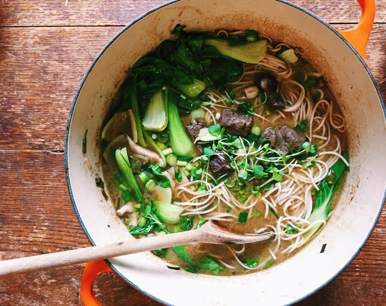 soup with beef, bok choi, microgreens, and asparagus