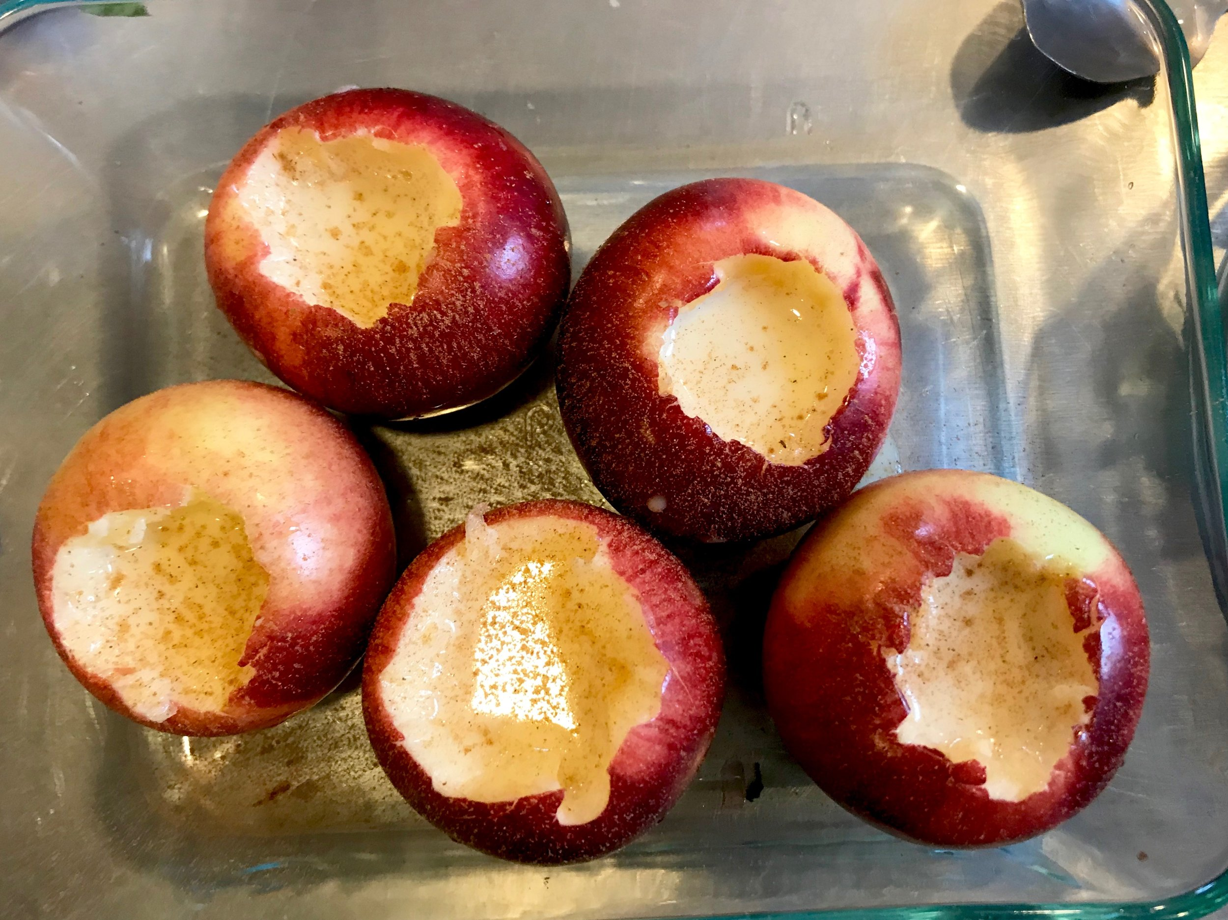 apples in baking pan with cinnamon and custard