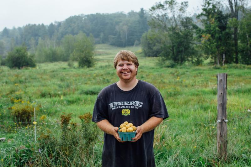 Jon Tisbert at Valley Dream Farm in Cambridge with some beautiful gold potatoes.