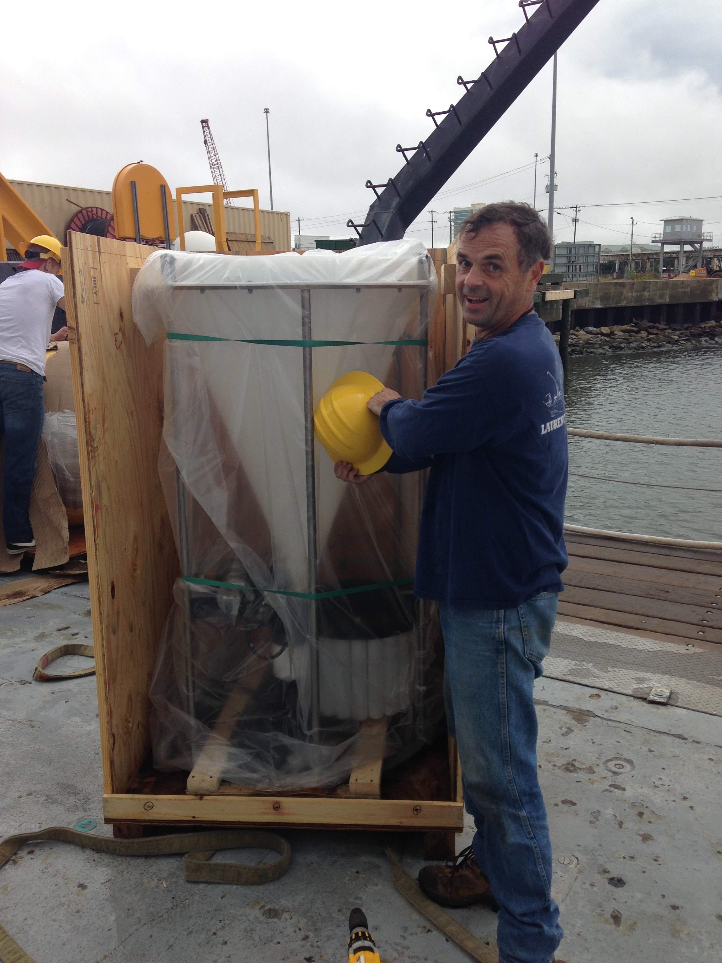 Eric Tappa with the new sediment trap. Credit: Julie Richey