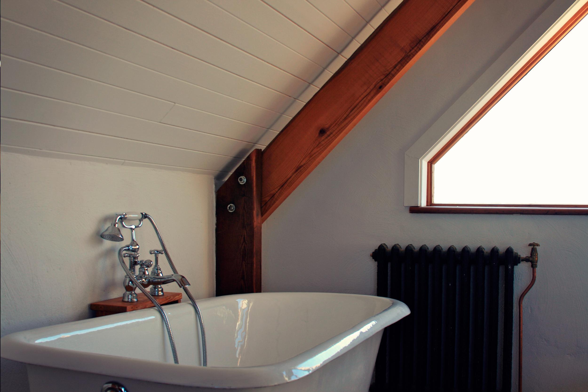 Cast iron bath and radiator on top floor