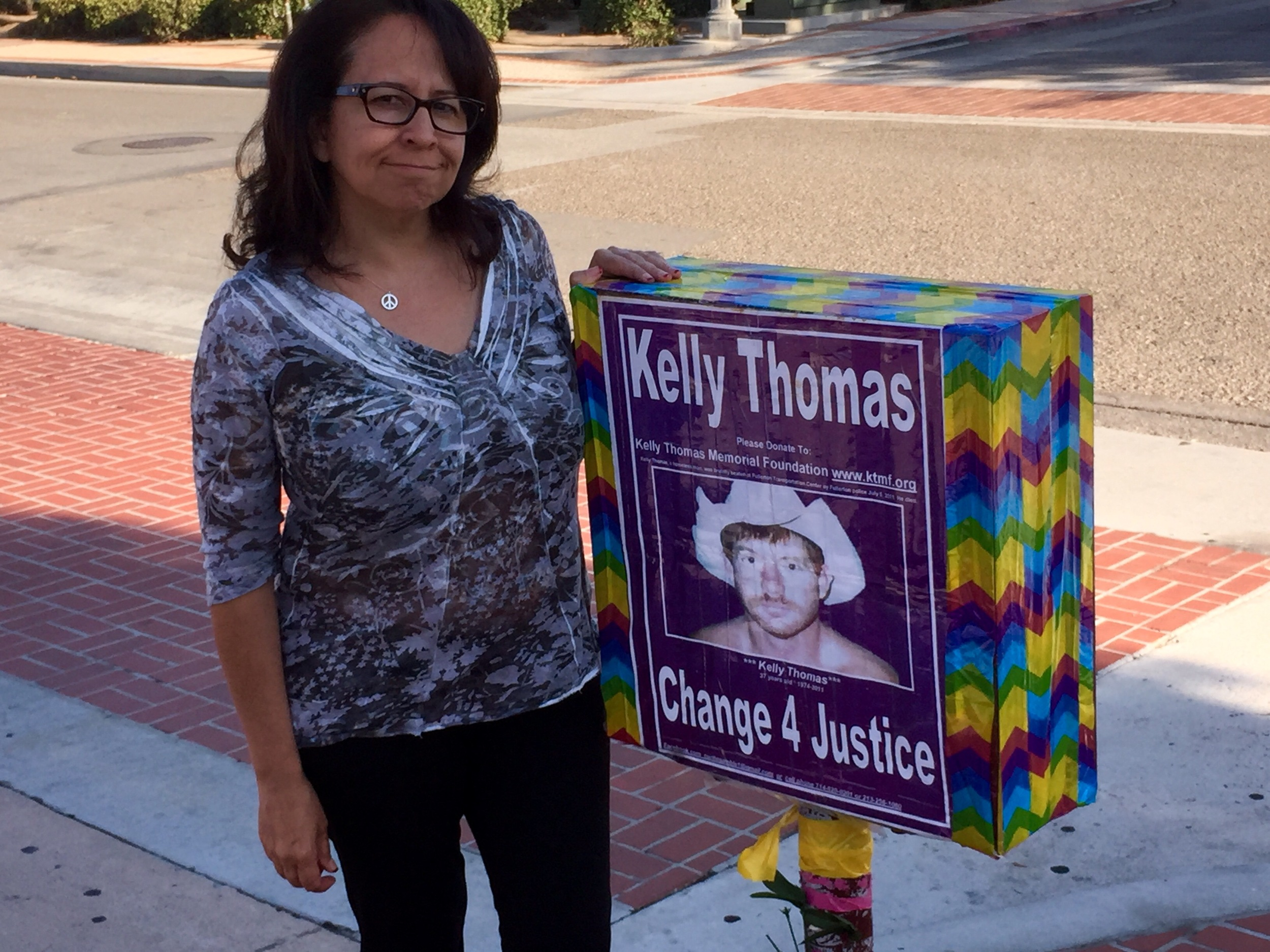 Dolores Sanchez at Kelly Corner, Fullerton, CA. The corner is the site of the death of Kelly at the hands of Fullerton Police.