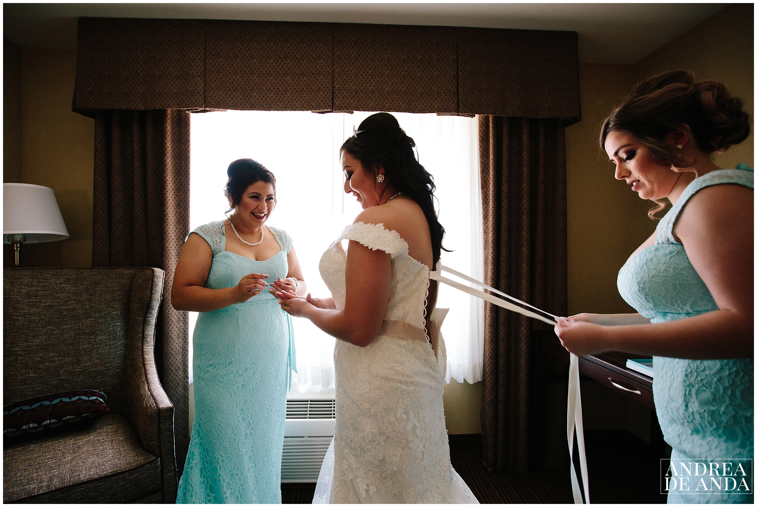 Bride and Bridesmaid at hotel room getting ready for ceremony