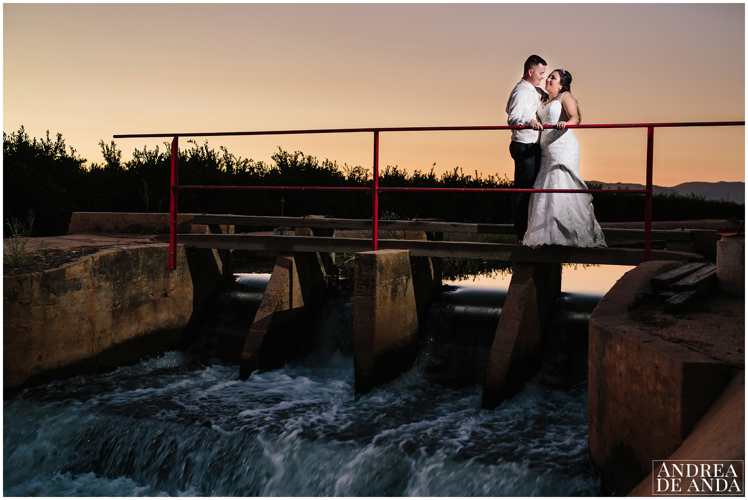 Bride and Groom creative portraits, Sunset Portraits at bridge above running water.