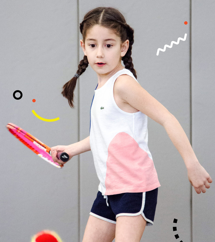Girl hitting a forehand