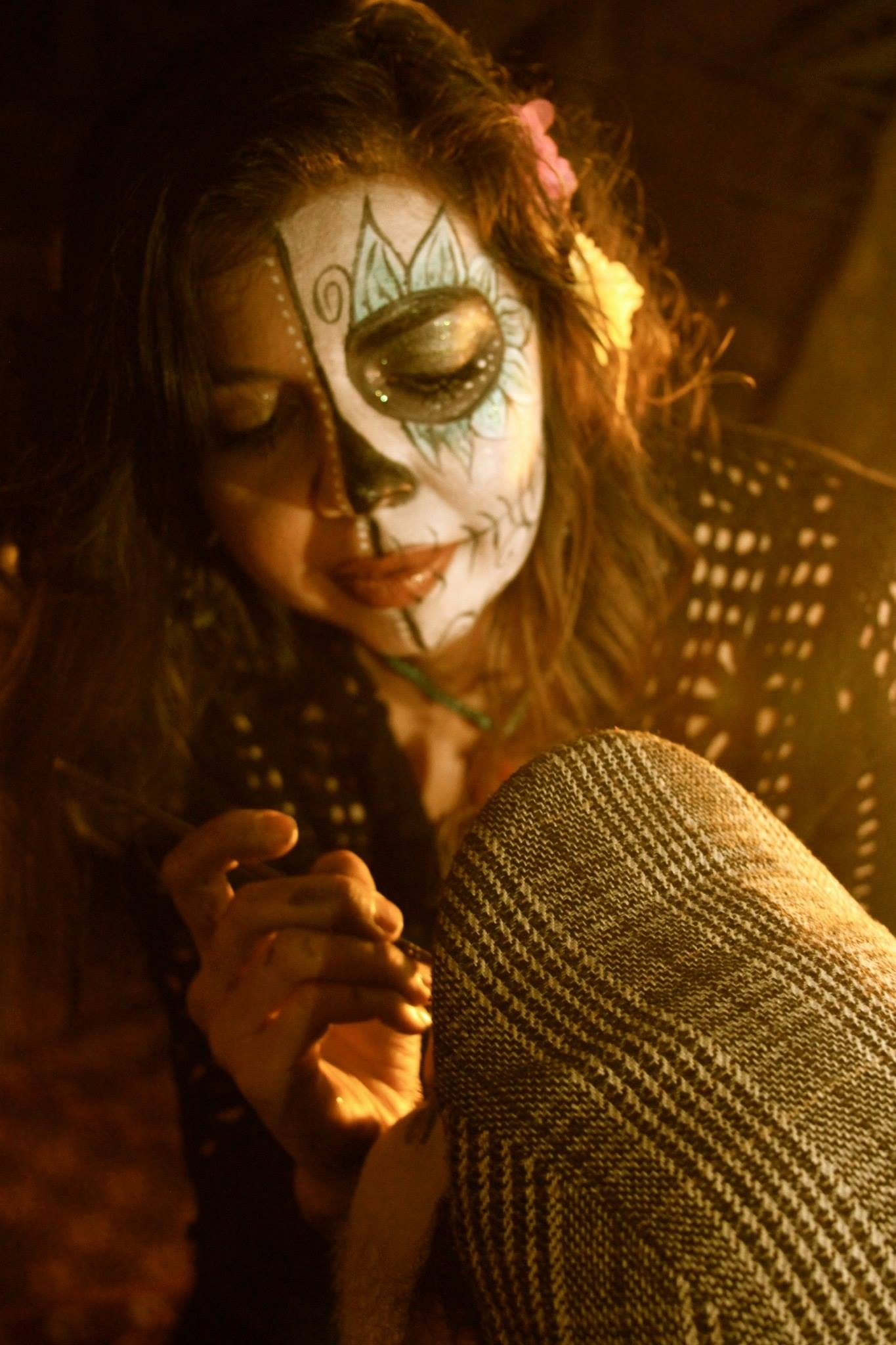 I typically paint faces for Day of the Dead. Here I am at work a couple of years ago.