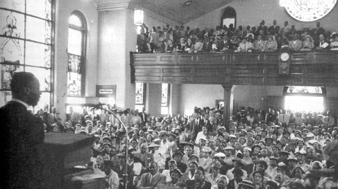 Mass meeting at Holt Street Baptist Church calls for a bus boycott, December, 1955.