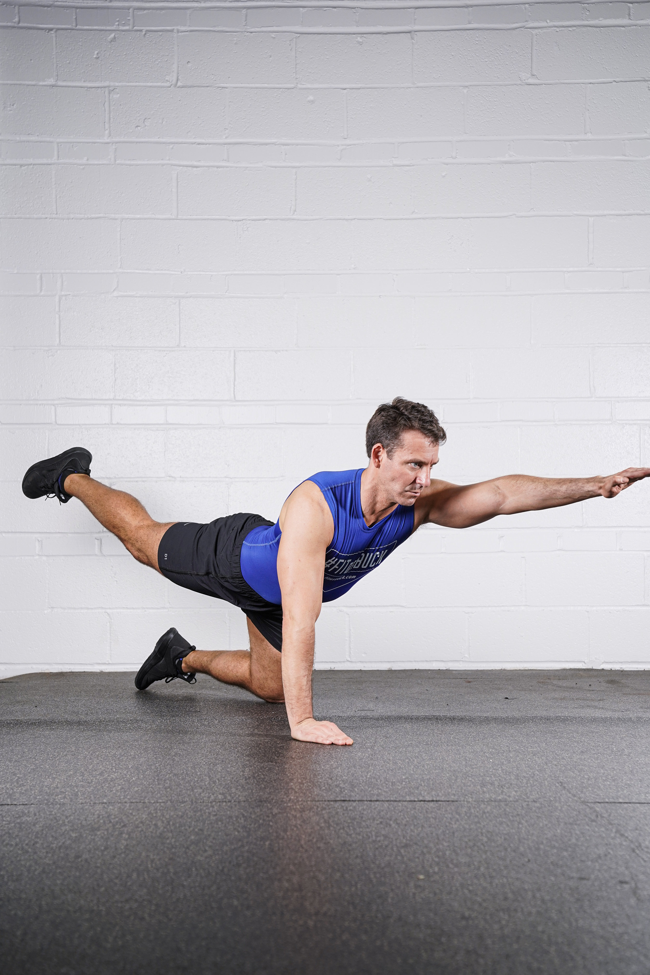 Bird Dog Hold - (left arm & right leg)- DURATION: 30 SECONDS- SETS: 1