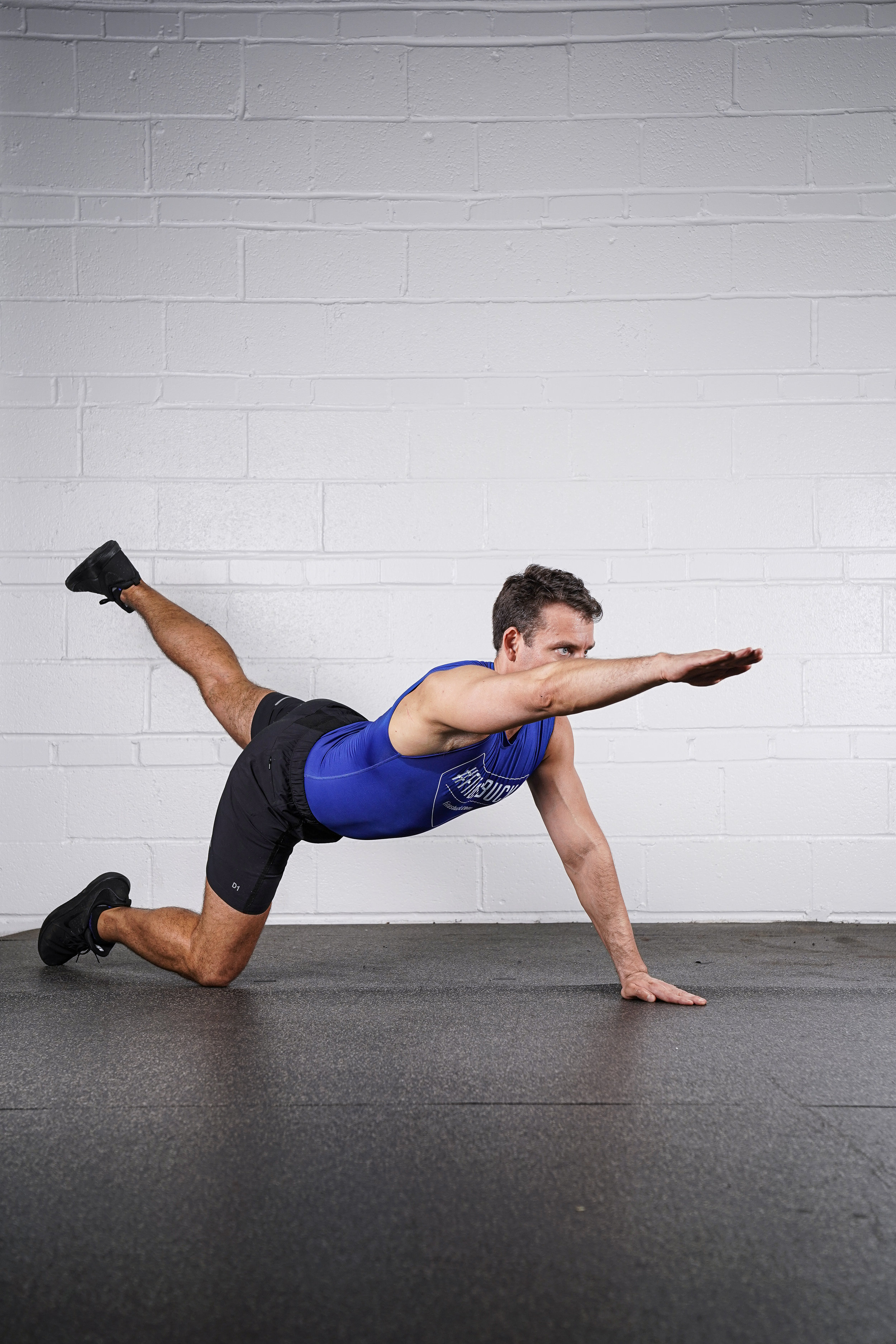 Bird Dog Hold - (right arm & left leg)- DURATION: 30 SECONDS- SETS: 1