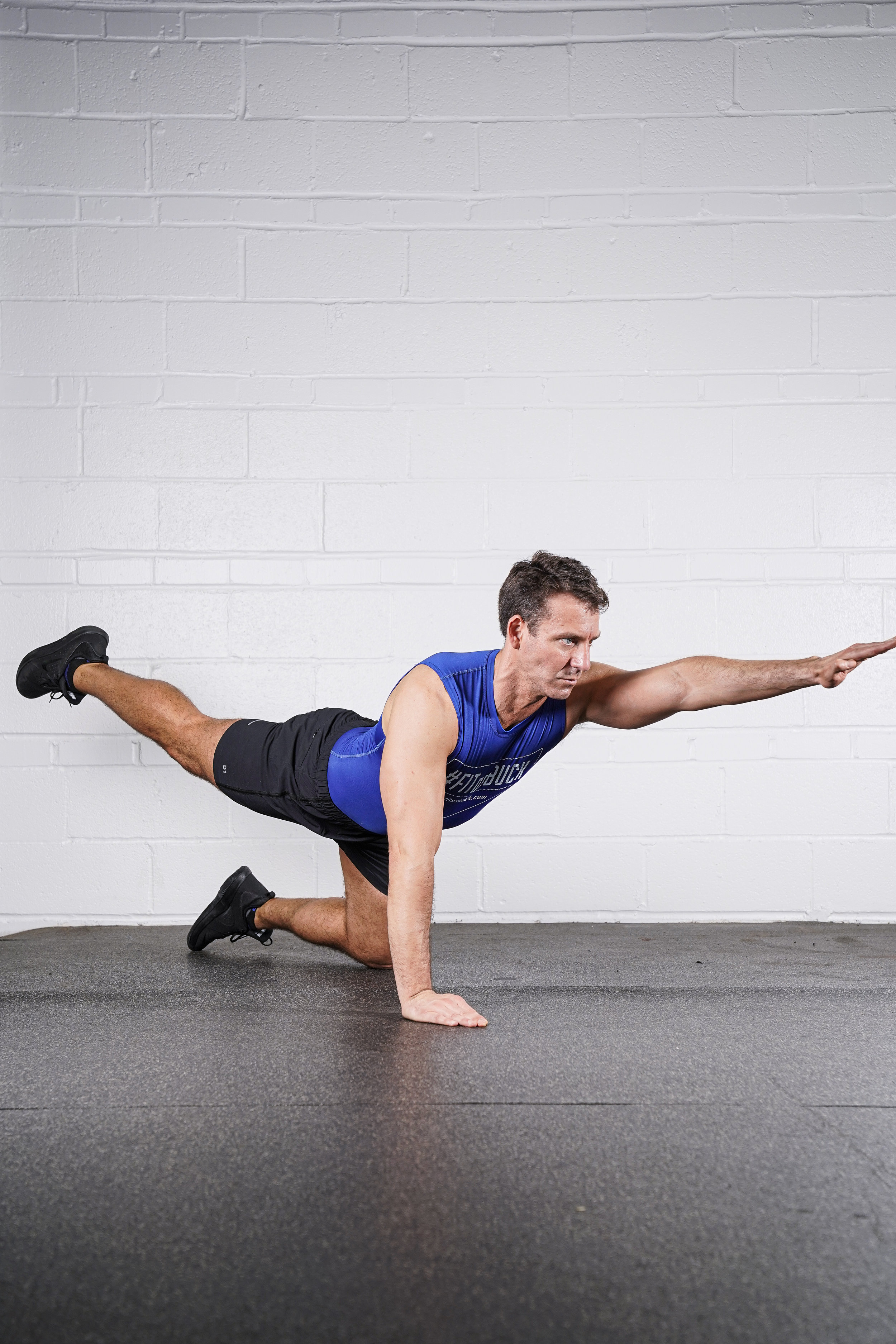 Bird Dog Hold - (left arm and right leg)- DURATION: 30 seconds- SETS: 1