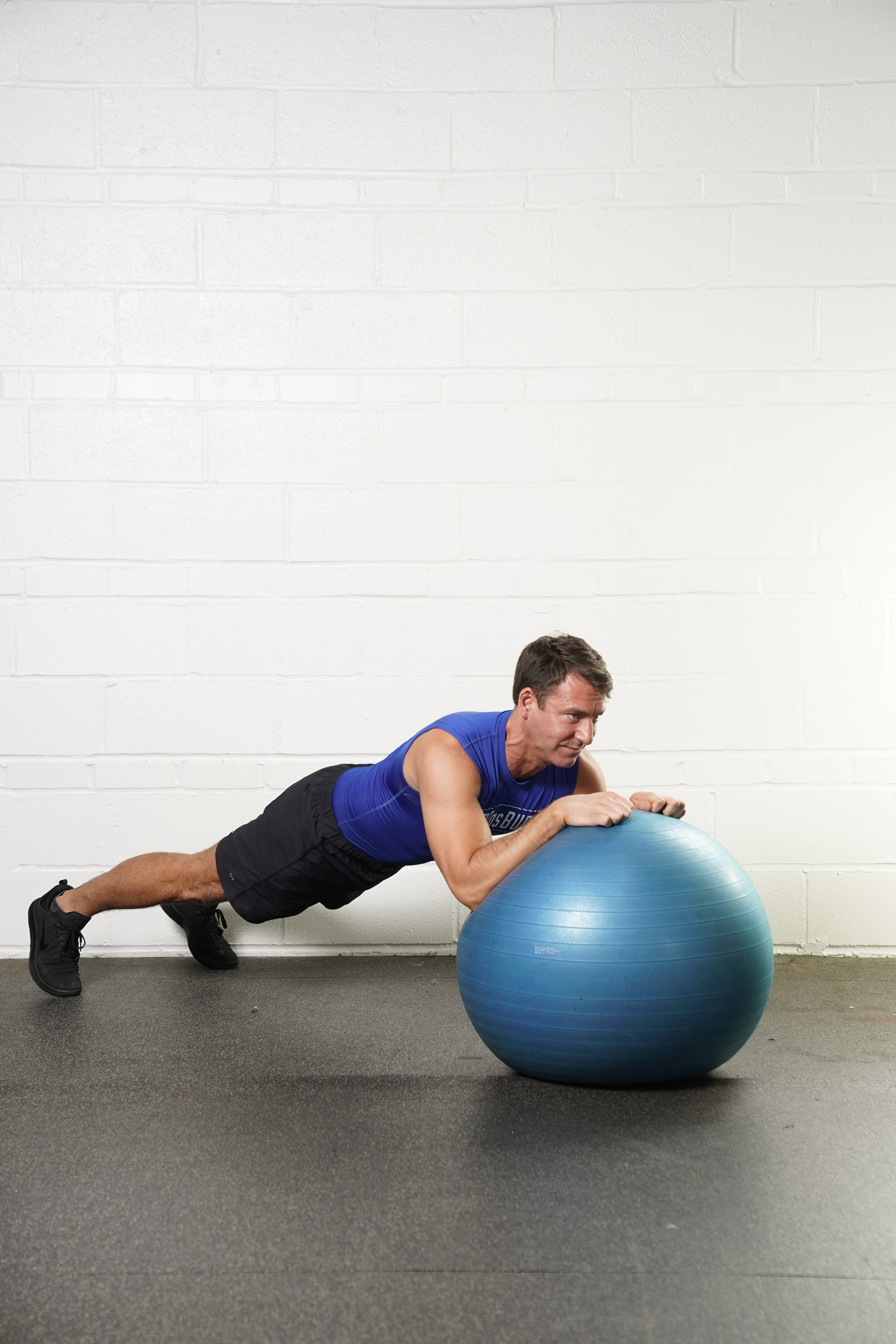 Stability Ball Plank Hold with Fist Pump - DURATION: 30 secondsNotes:- The fist pumps can be really small- As your forearms move, keep the rest of your body completely stable: hips squared off with your shoulders, feet planted with your weight shifted back toward your heels.