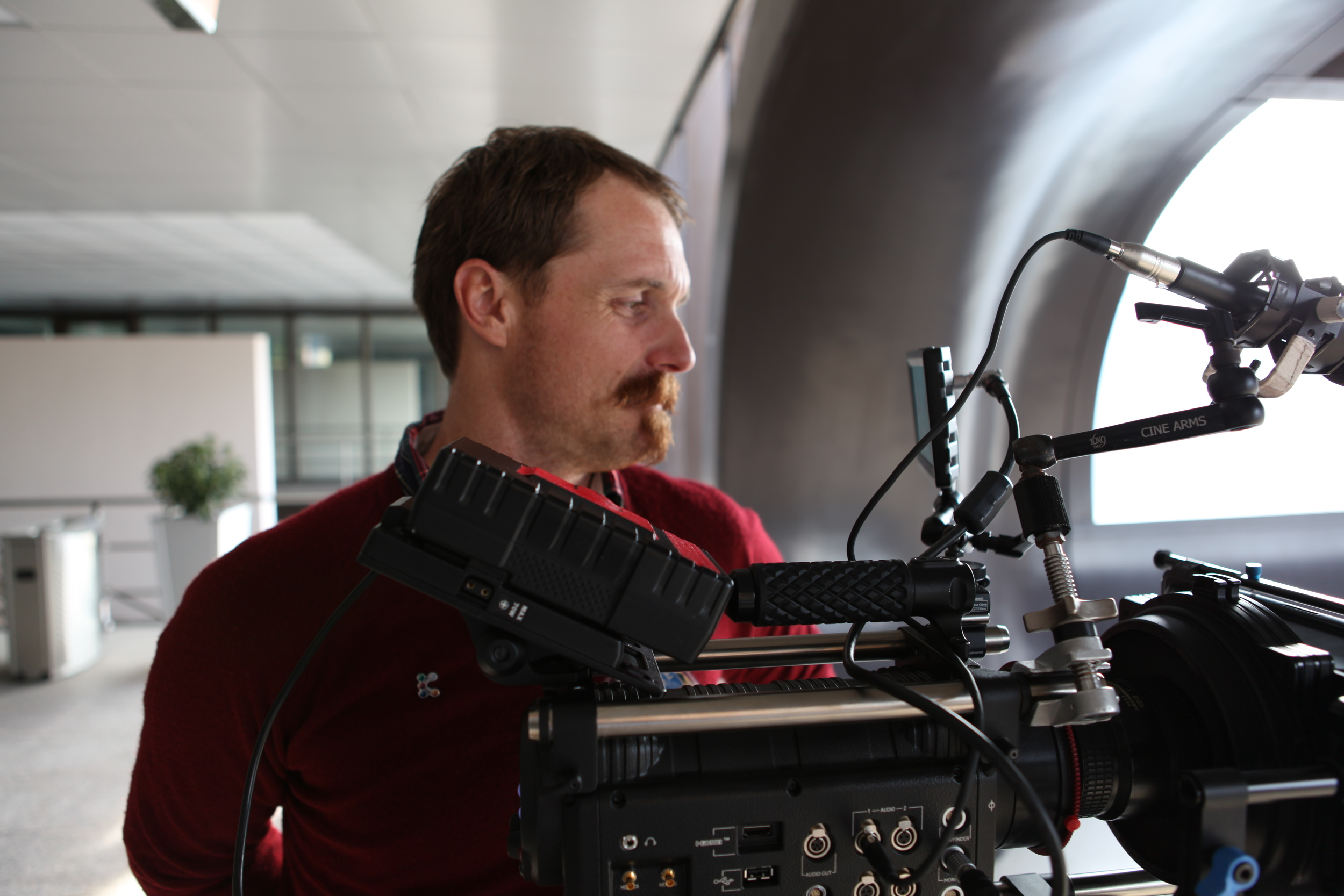 Director / DP Vern Moen shooting broll at the K-show in Dusseldorf, Germany.