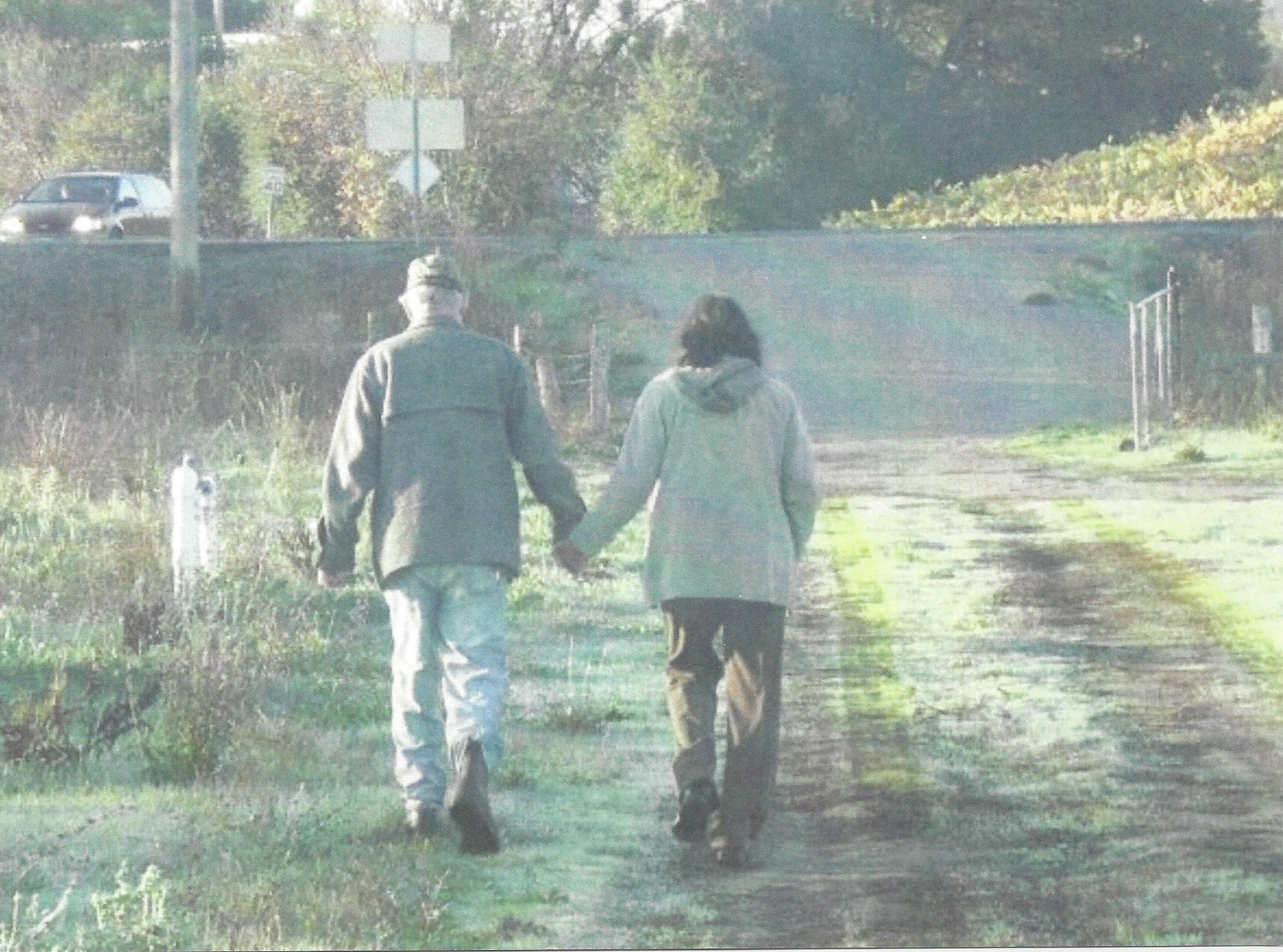 AMSD Andy Mamta walking Farm Backshot.jpeg